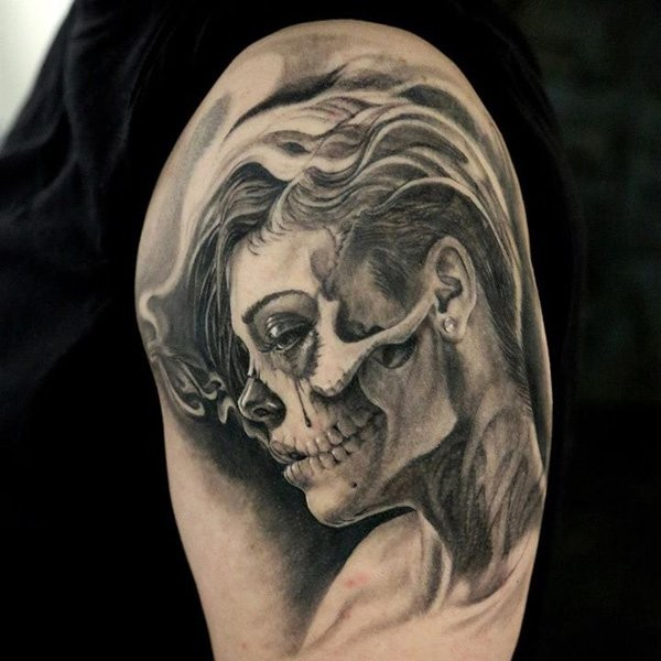 Realism style black and white shoulder tattoo of smoking woman portrait with skull face