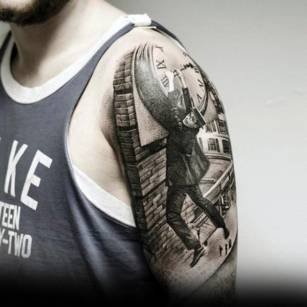 Realism style black and white shoulder tattoo of man hanging on tower clock