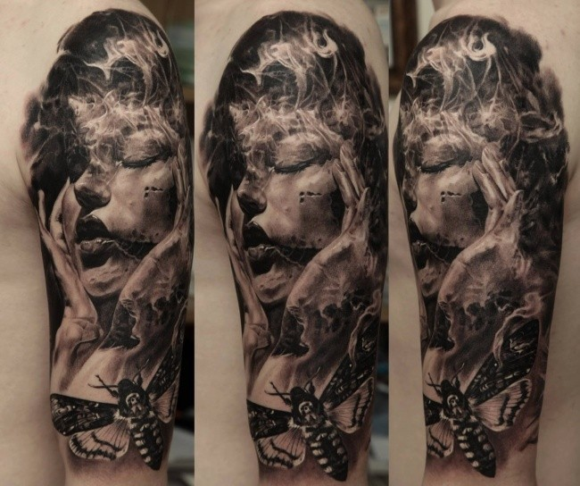 Realism style black and white shoulder tattoo of terrifying woman with butterfly