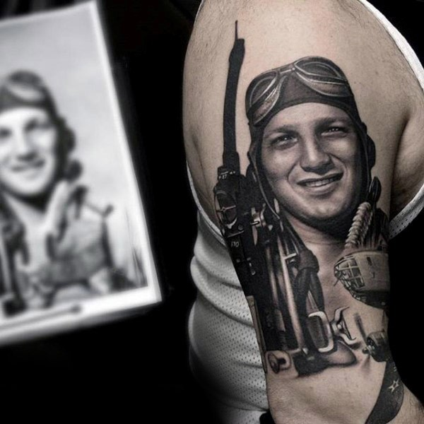 Realism style black and white shoulder tattoo of WW2 pilot with plane