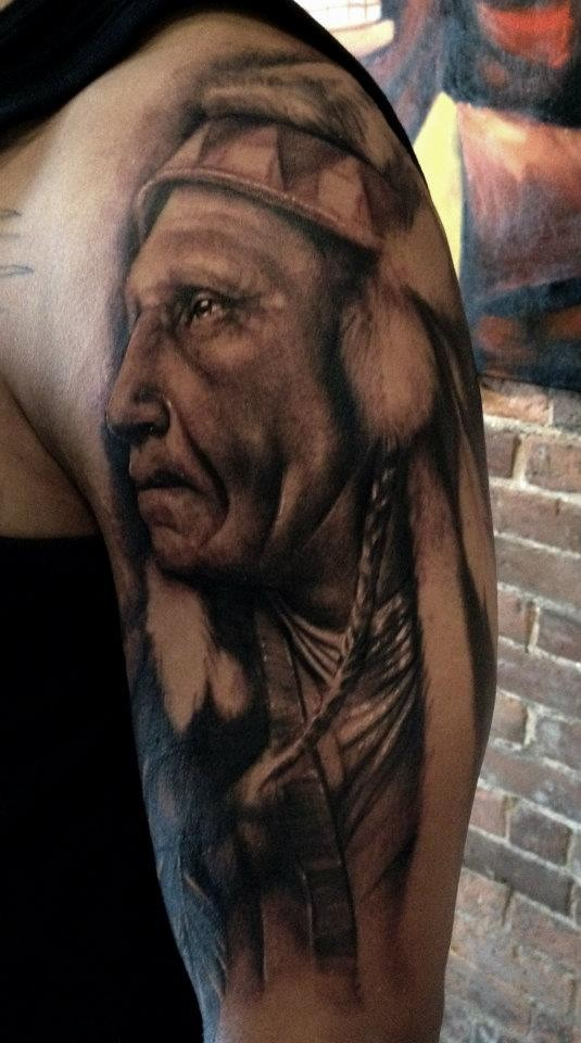 Realism style black and white shoulder tattoo of old Indian