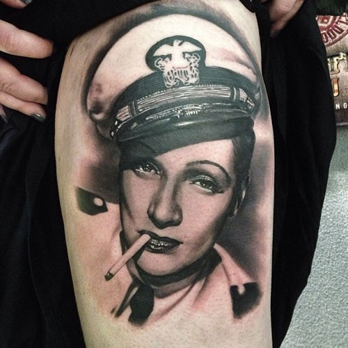 Realism style black and white smoking woman portrait tattoo on thigh