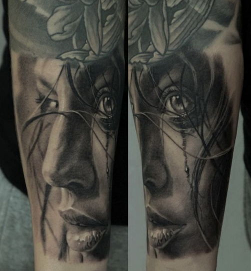 Realism style black and white woman portrait tattoo