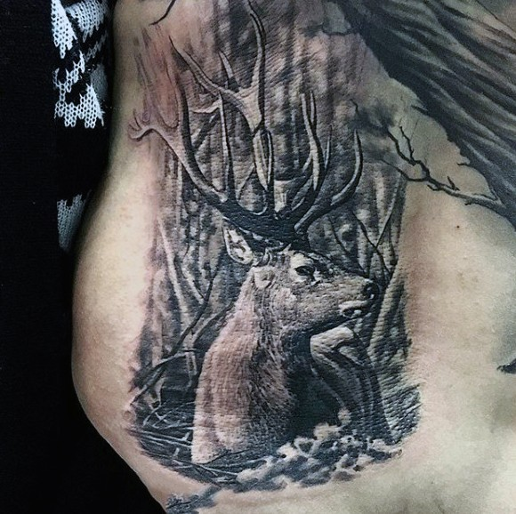 Realism style black ink belly tattoo of deer in dark forest