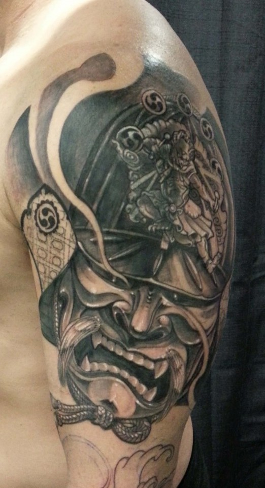 Realism style black ink big shoulder tattoo of angry samurai helmet and mask