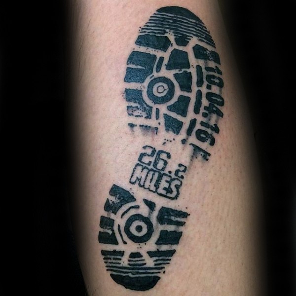 Realism style black ink foot print tattoo with lettering