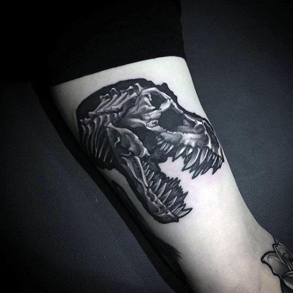 Realism style black ink leg tattoo of dinosaur skull