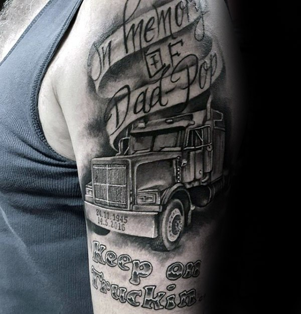 Realism style black ink shoulder tattoo of big truck and lettering
