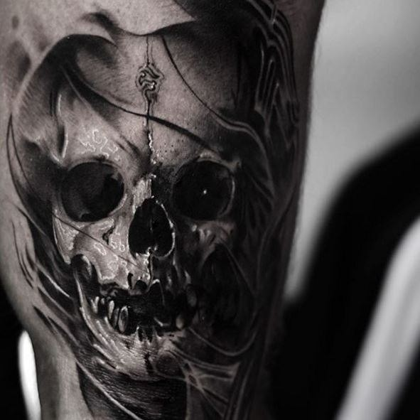 Realism style black ink tattoo of fantasy skull with symbol