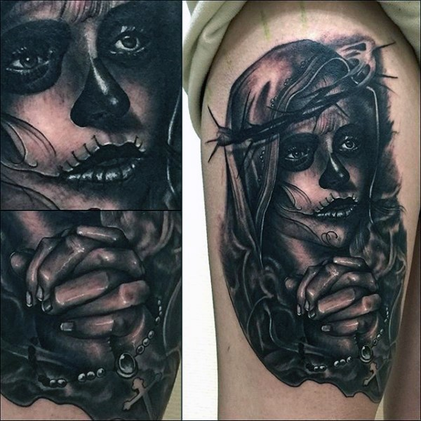 Realism style black ink thigh tattoo of woman with mask and vine
