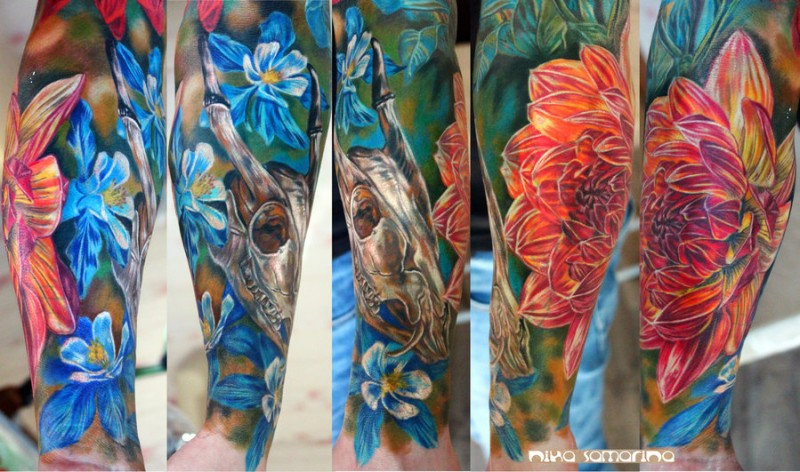 Realism style colored animal skull with beautiful flowers tattoo on forearm