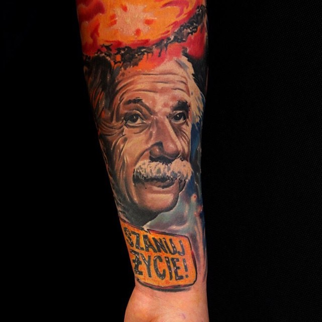 Realism style colored arm tattoo of Einstein face with lettering