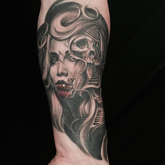 Realism style colored arm tattoo of creepy woman stylized with human skull