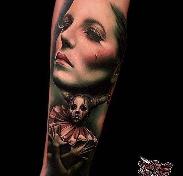 Realism style colored arm tattoo of crying woman with clown woman