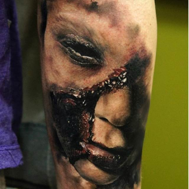 Realism style colored arm tattoo of demonic woman