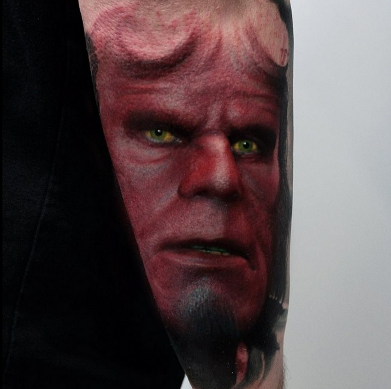 Realism style colored arm tattoo of famous hero Hellboy