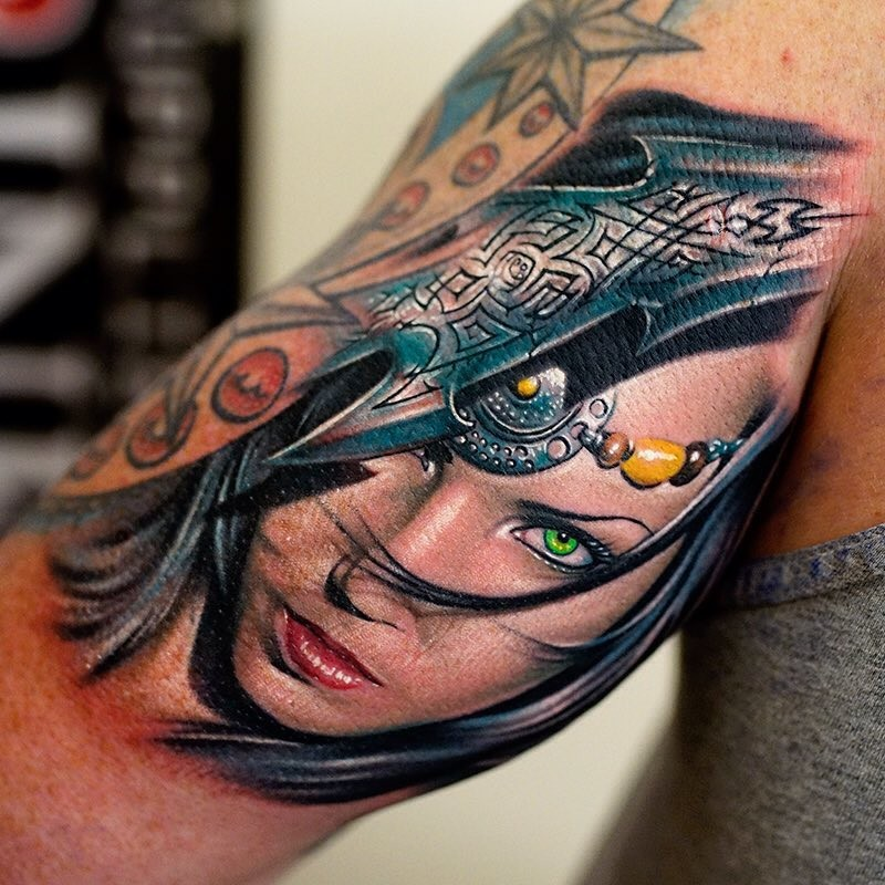 Realism style colored arm tattoo of fantasy woman portrait with helmet