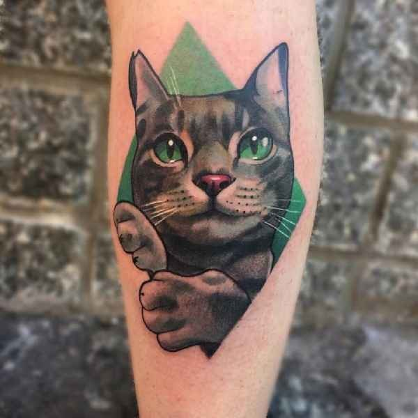 Realism style colored arm tattoo of funny cat