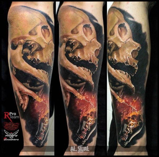 Realism style colored arm tattoo of human skull with bulb