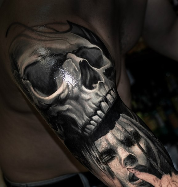 Realism style colored arm tattoo of human skull with woman face