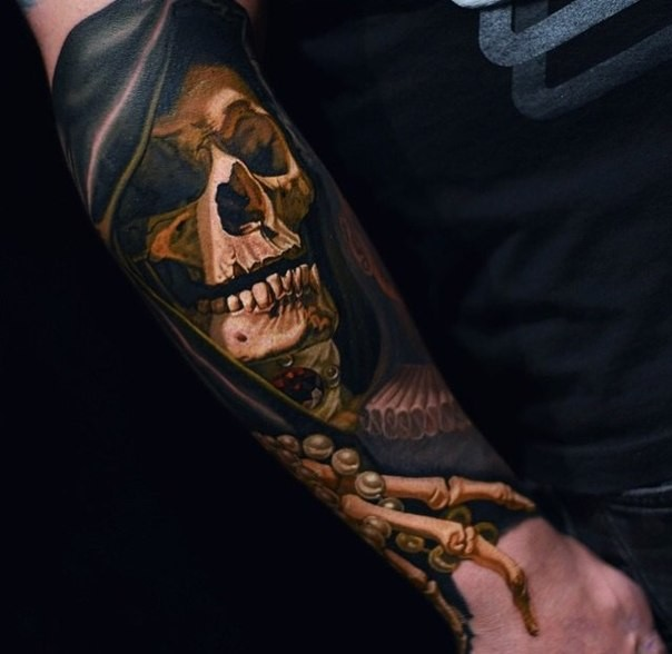 Realism style colored arm tattoo of human skeleton with Grimm reaper