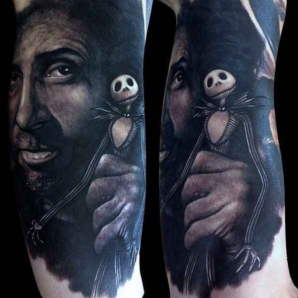 Realism style colored arm tattoo of man with Nightmare before Christmas hero doll