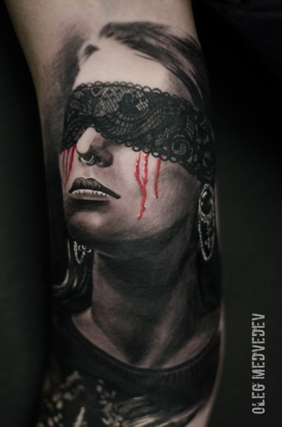 Realism style colored arm tattoo of masked woman with pierced nose