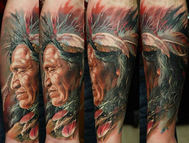 Realism style colored arm tattoo of old Indian with feather