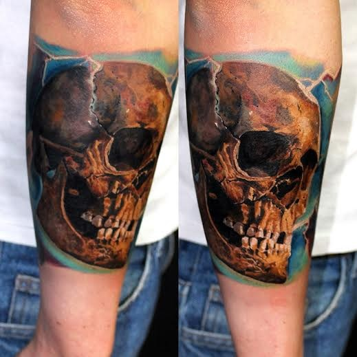 Realism style colored arm tattoo of very detailed human skull