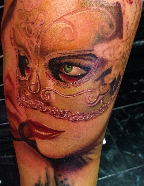 Realism style colored arm tattoo of woman with mask
