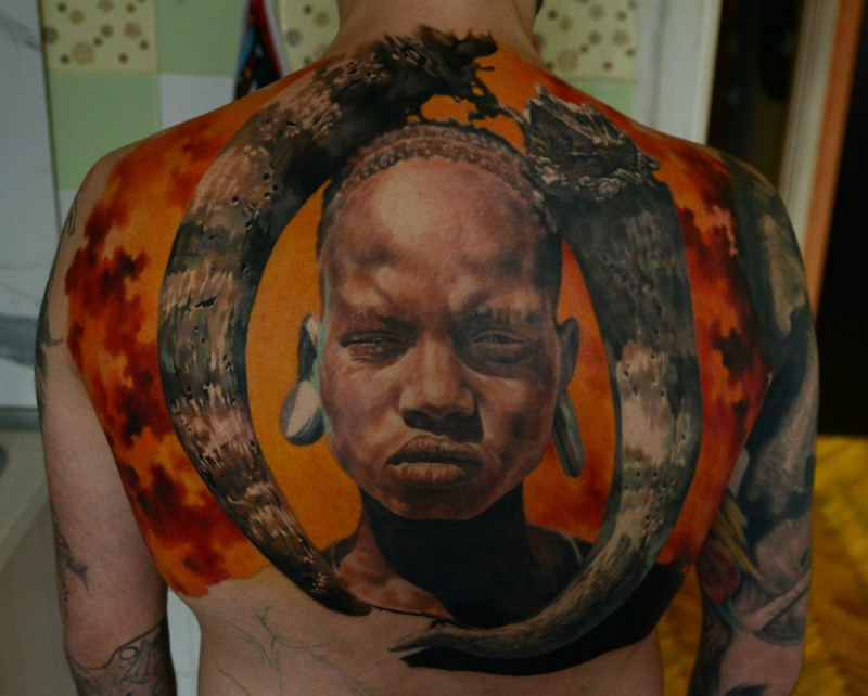 Realism style colored back tattoo of ancient tribe man