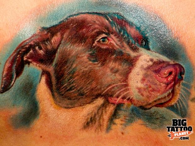 Realism style colored back tattoo of very detailed dog