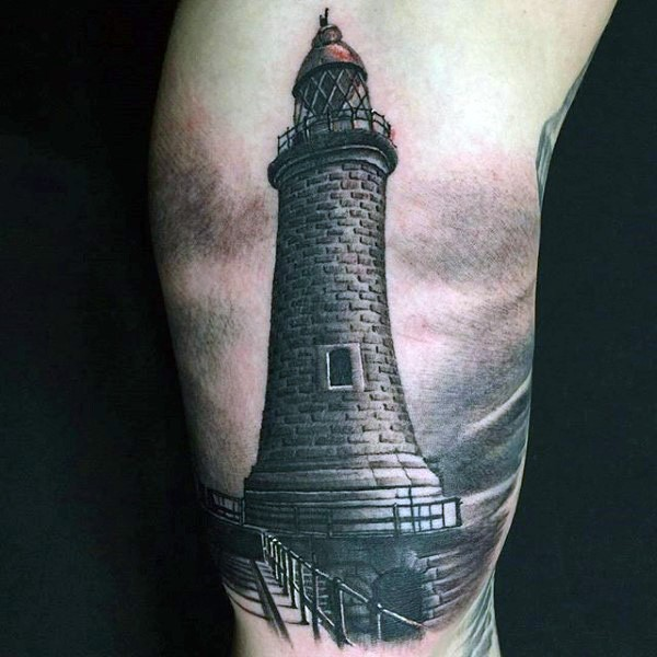 Realism style colored biceps tattoo of stone lighthouse