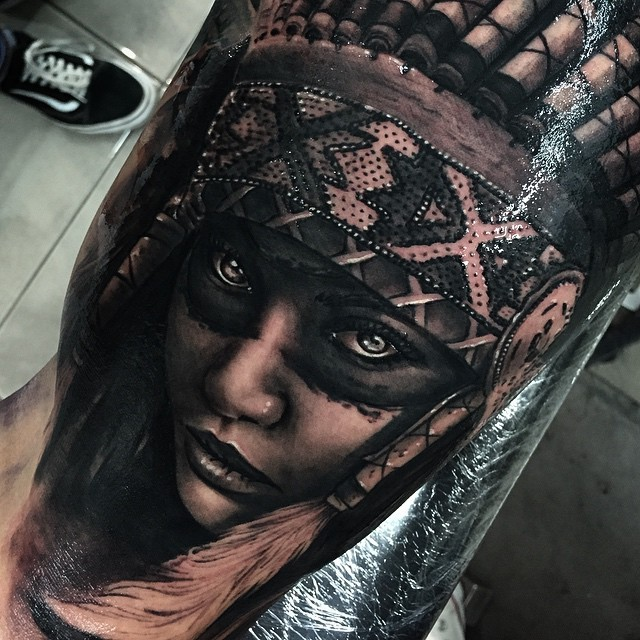 Realism style colored biceps tattoo of Indian woman with helmet