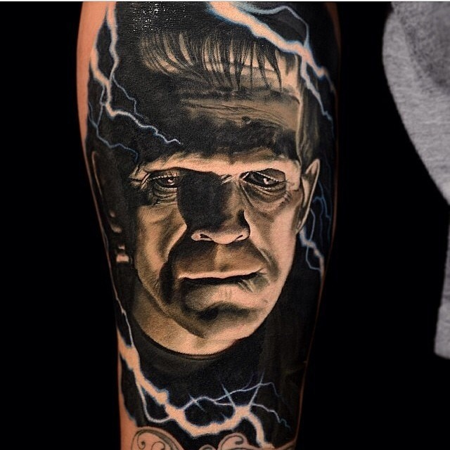 Realism style colored forearm tattoo of Frankenstein monster portrait