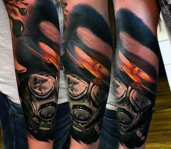 Realism style colored forearm tattoo of nuclear blast and gas mask