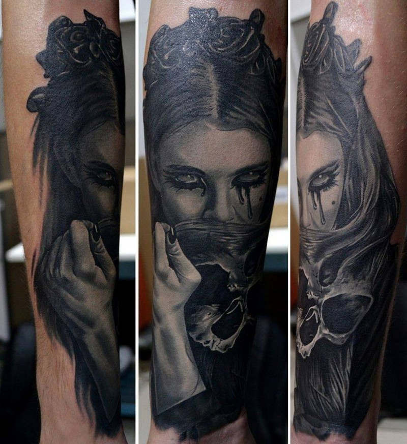 Realism style colored forearm tattoo of crying woman with skull