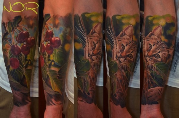 Realism style colored forearm tattoo of wild cat with cherries