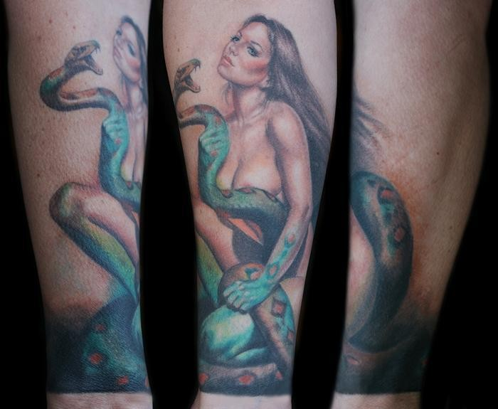 Realism style colored forearm tattoo of woman with big snake