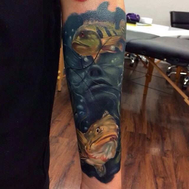 Realism style colored forearm tattoo of drowned woman with fishes