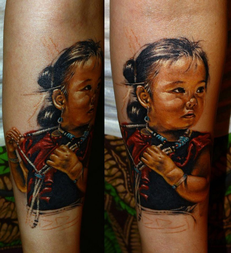 Realism style colored forearm tattoo of small Asian girl