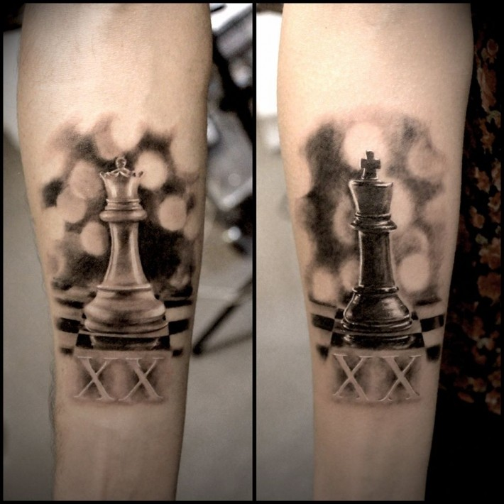 Realism style colored forearm tattoo of chess figures