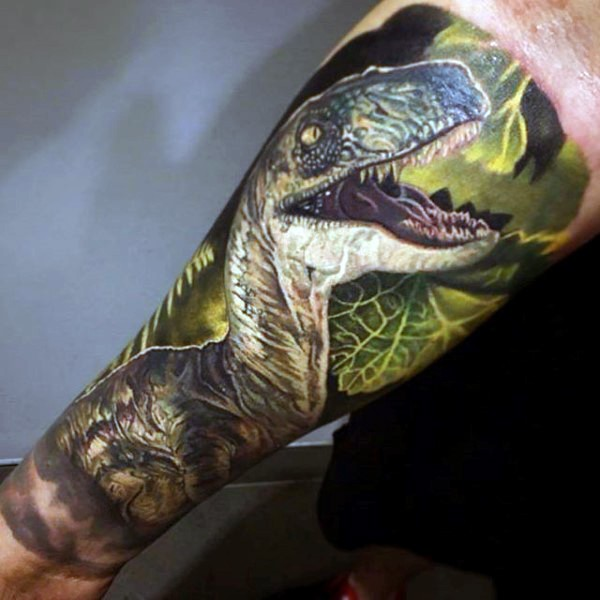 Realism style colored forearm tattoo of roaring dinosaur