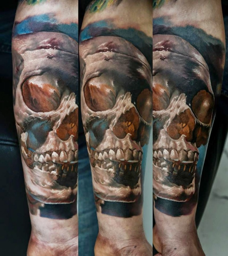 Realism style colored forearm tattoo of big human skull