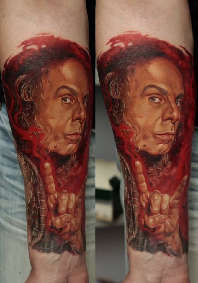 Realism style colored forearm tattoo of man portrait