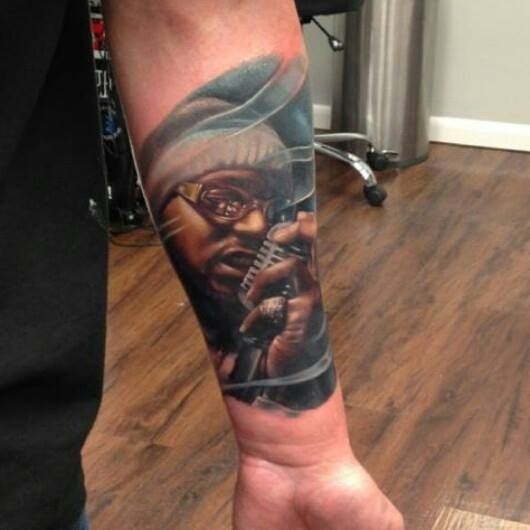 Realism style colored forearm tattoo of old singer