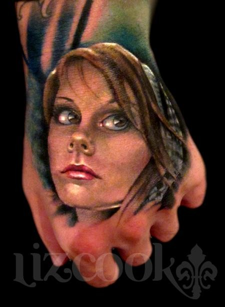 Realism style colored hand tattoo of woman face