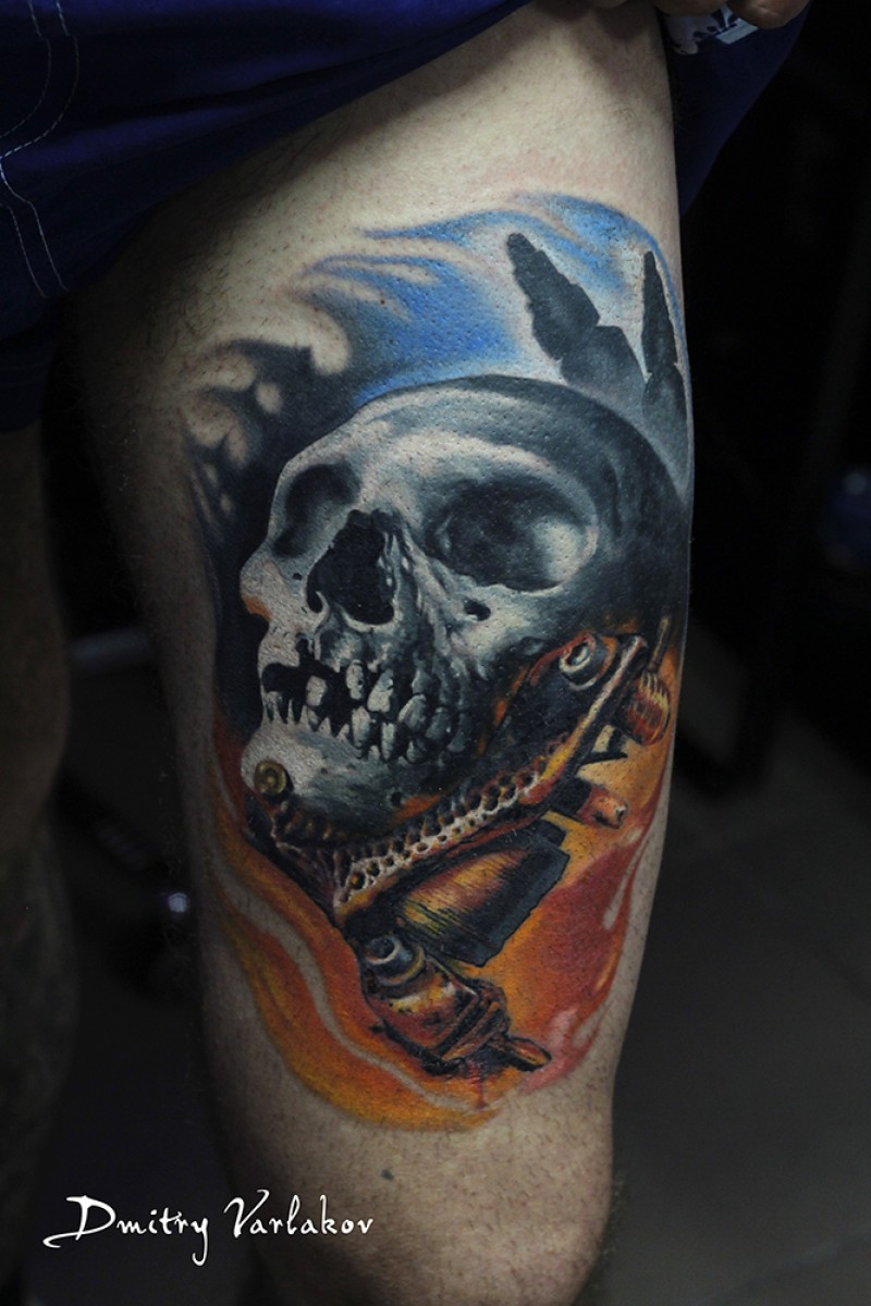 Realism style colored human skull tattoo on thigh