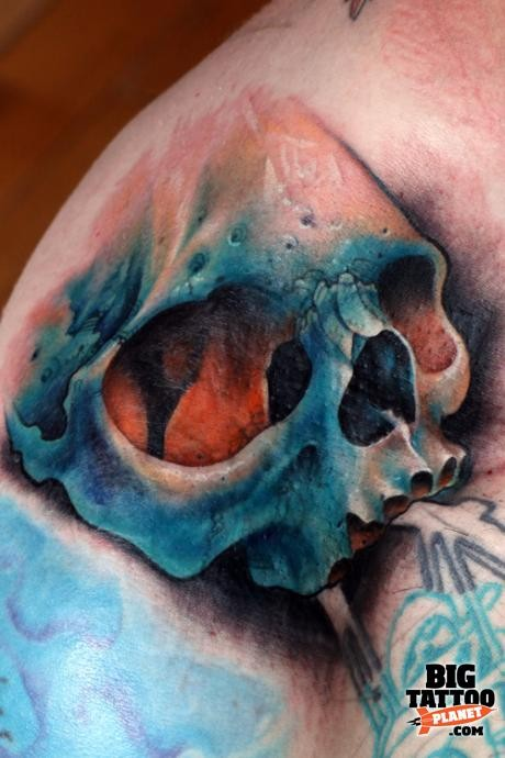 Realism style colored large shoulder tattoo of human skull
