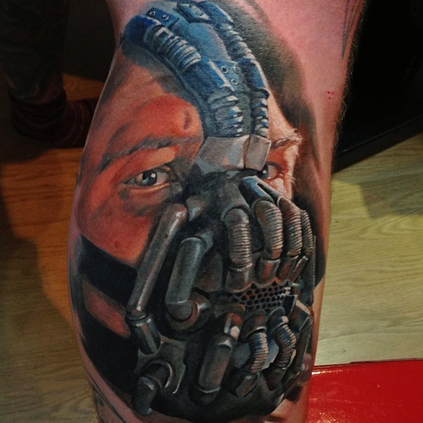 Realism style colored leg tattoo of Batman Bane portrait